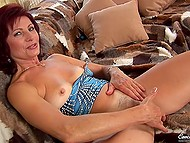 Beautiful mature thrusts blue sex toy into moist trimmed vagina till achieving pleasure