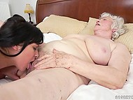 Dark-haired girl shows the lady why she became a lesbian and licking that old pussy