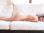 Solo video of a lovely young girl handjob on a white couch, lying on his chest