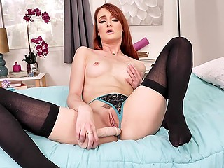 Middle-aged redhead in panties and stockings plays with pussy to make guys ejaculate