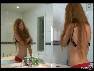 Norwegian hottie with ginger hair taking bath by candlelight