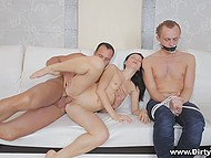 Well-built hunk actively penetrates slender brunette Greta A near her tied up boyfriend