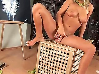 Lovely blonde stripping off and starting masturbation