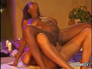 Dark-skinned lady gets white and black dick in her holes