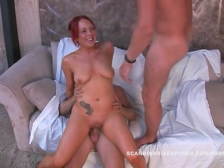 Redhead Danish MILF pleases two men with her mouth and pussy