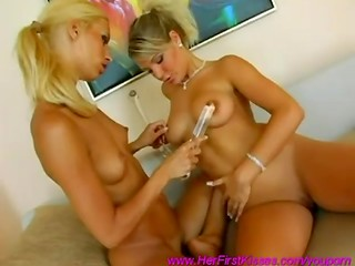 Two slim lesbians from Czech Republic amuse with glass dildo