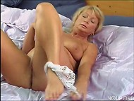 Mature blonde dildoing her pussy to orgasm 5