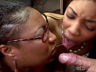 Two crazy Ebony MILFs can't stop sucking delicious white cock before it gives some fresh cum