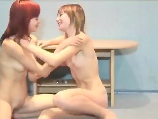 Very young Slovakian girls kissing on the floor
