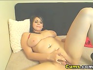 Flawless Latina coquette licks her pair of huge boobies while playing with pussy on the webcam