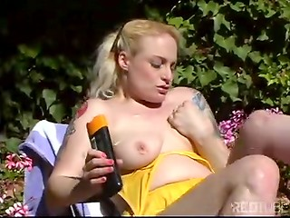 Busty blonde massages her pussy outdoors till she squirts