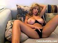 Amateur MILF plays with her pussy through her black panties on the webcam 9