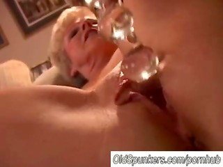 Amateur blonde granny spreads her legs in sexy stockings and shoves dildo in the shaved pussy