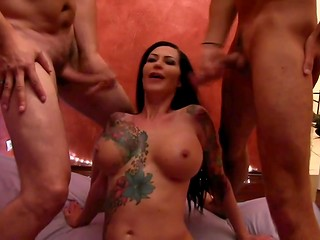 Busty German brunette meets two cocks in her wet holes in the threesome action