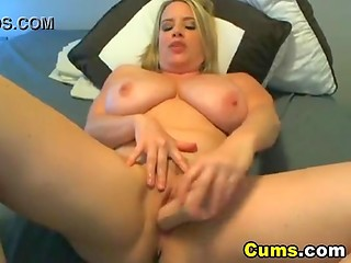 Flawless blonde girl with amazing set of huge boobies shoves big dildo in her snatch