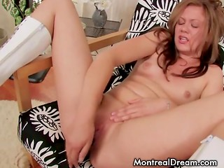 Young flirt with natural tits played with the black dildo like a horny nympho in the solo scene