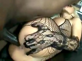 Blonde in mesh clothing takes huge black dick up her ass