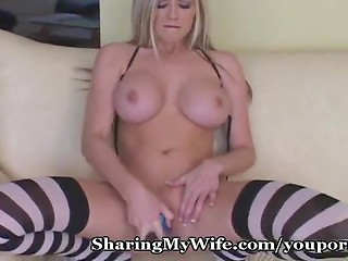 Fabulous busty blonde goddess spreads her legs and starts masturbating using her blue dildo