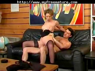 Attractive woman gets pounded on the black leather sofa