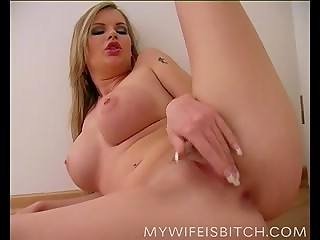 Blonde takes off her red lingerie and strokes her pussy