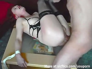 Tied lady gets her pussy fisted on the table