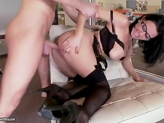 Sexy MILF boss in stockings seduces nervous young man and fucks him