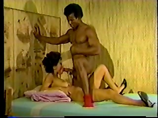 Black-skinned guy fucks his cute Ebony girlfriend in the homemade vintage video