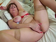 Amateur mature lady in sexy stockings lies alone and gently fingers her sweet snatch 7