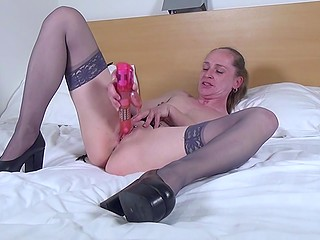 Mature woman in stockings fingered pussy but vibrator would bring her more pleasure