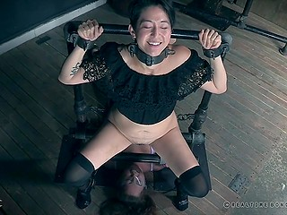 Petite Asian MILF tries to piss on her helpless girlfriend while she is chained and bound