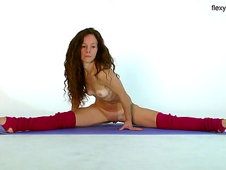 Naked body of athletic babe is pretty flexible but hair falling down on small boobs is terrific