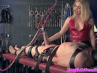 White-headed mistress tied disobedient man to table and tried to make his cock bigger