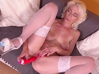 Experienced blonde in white stockings uses red dildo to please all her sexual fantasies
