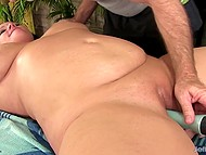 Gray-haired masseur relaxes chubby brunette client using skillful hands and his favorite vibrator 6