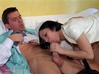 Brunette nurse with big tits in a white robe invited doctor to office to give him a blowjob