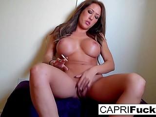 Solo scene where stunning Capri Cavanni with big breasts smokes before pussy masturbation