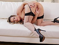 Pornstar with curvaceous shapes wears flesh-colored stockings and gets it on alone 6