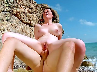 French MILF with eyebrow piercing and tattoos on back fucked in both holes on the beach