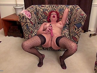 Mature lady with red hair masturbates pussy waiting for husband to make love to him