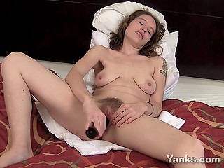 Alone sexpot besides fun with usual sex toys loves to stuff her unshaved pussy with cucumber