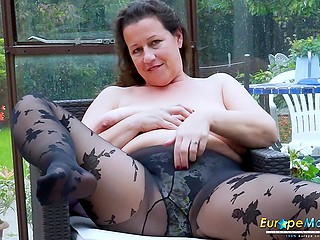Playful Euro mature in sexy black pantyhose doesn't hesitate to show amazing natural jugs on camera