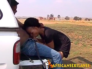 Pretty African girl carefully sucks and rides friend's fuckstick during spontaneous sex in his jeep
