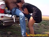 Pretty African girl carefully sucks and rides friend's fuckstick during spontaneous sex in his jeep 4