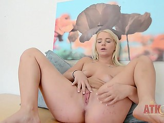 Enticing blonde takes off black lingerie and is willing to rub gently her shaved pussy with vibrator