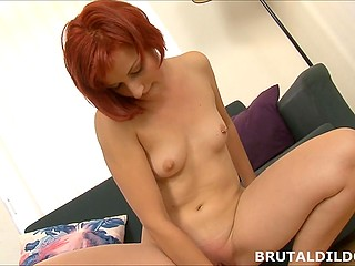Shameless redhead uses thick dildo to fuck herself and moans because of carnal pleasure