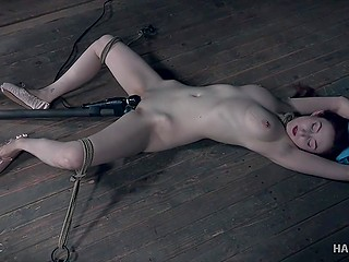 Man tied skinny girl up to the floor and shoved sex toy in muff going to set the machinery in motion