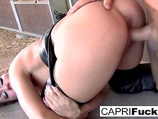 Jockey Capri Cavanni and muscular horseman have spontaneous sex marathon right in stable
