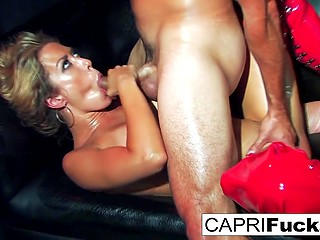 Stripper Capri Cavanni takes everything off exposing body and leaves red boots only being fucked by client