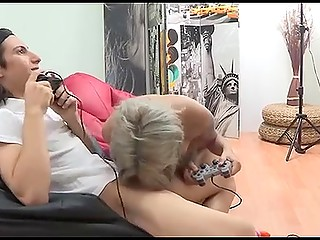Sensuous female with small waist takes cock in mouth and gives a blowjob to gamer boy