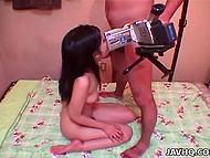 Юная японка с заросшей киской старательно ласкает ротик член худощавого порно агента 4